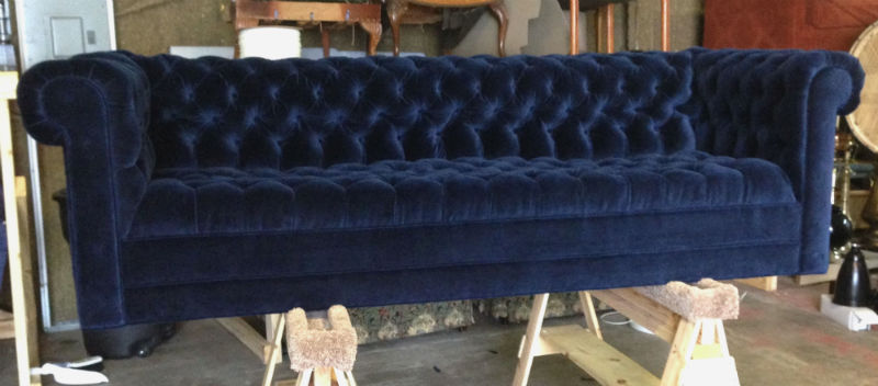 An impressive Chesterfield sofa upholstered by Kristen Williams.
